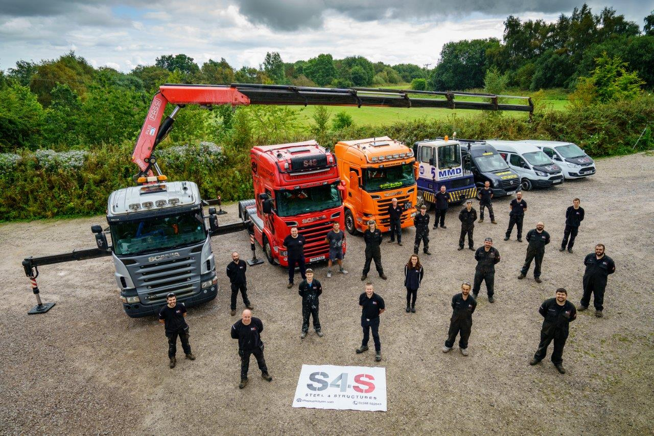 The S4S team with some of their fleet of vehicles.jpgLR.jpg